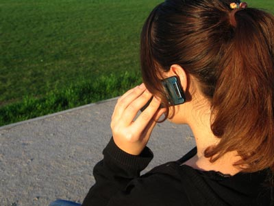 A girl on a cellular phone.