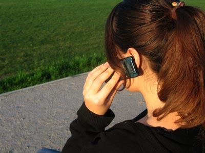 A girl on a cellular phone.